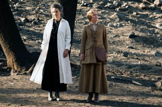 "TIMELESS -- ""The War to End All Wars"" Episode 201 -- Pictured: (l-r) Kim Bubbs as Marie Curie, Susanna Thompson as Carol -- (Photo by: Justin Lubin/NBC)"