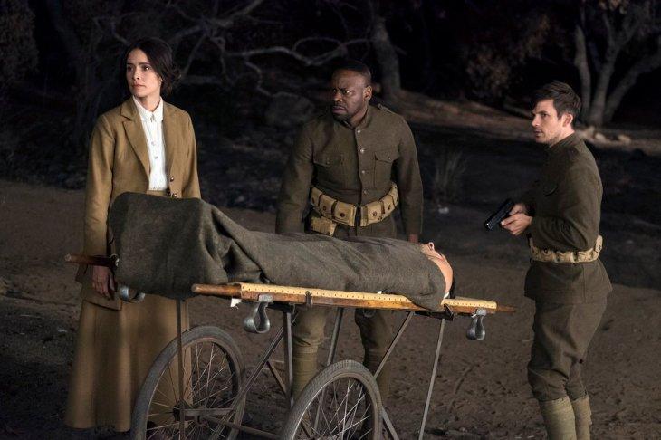 "TIMELESS -- ""The War to End All Wars"" Episode 201 -- Pictured: (l-r) Abigail Spencer as Lucy Preston, Matt Lanter as Wyatt Logan, Malcolm Barrett as Rufus Carlin -- (Photo by: Justin Lubin/NBC)"